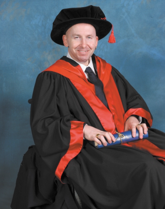 Peter in graduation robes